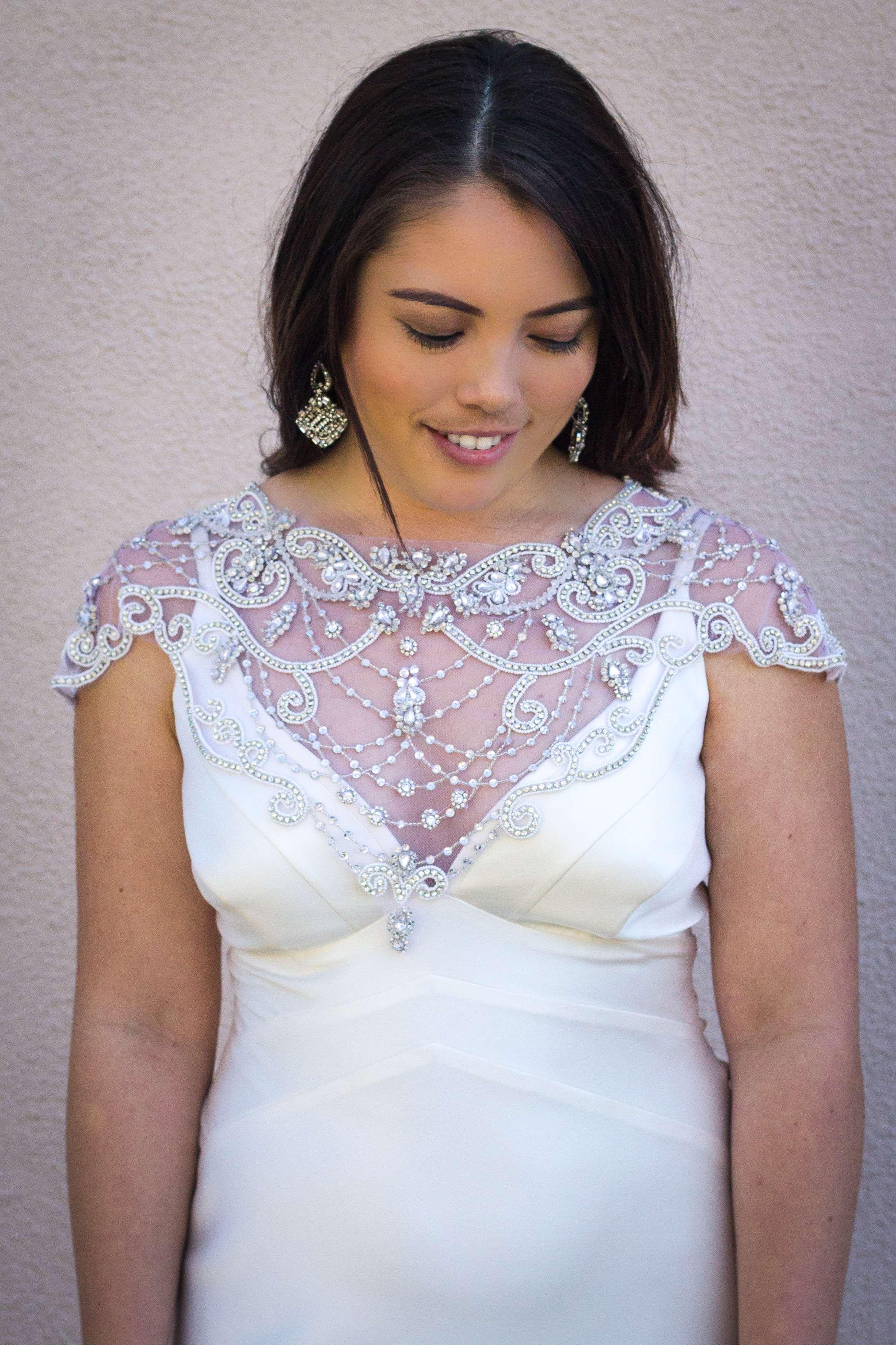 Dress: Suzanne Neville | Beaded cap sleeve: Theia | Earrings: Maria Elena